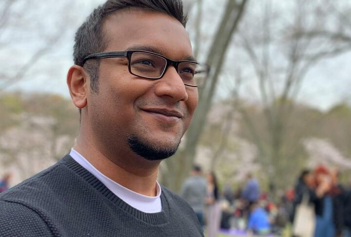 Young man with eye glasses looking to the right