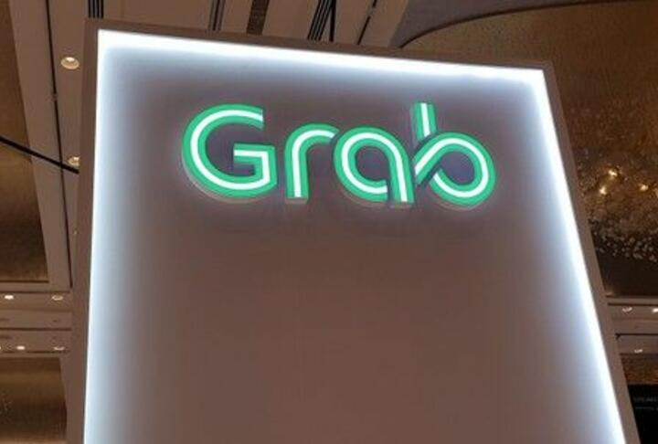 A Grab logo is pictured at the Money 20-20 Asia Fintech Trade Show in Singapore