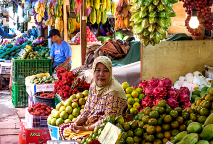 Woman selling fruits in a market in Phillipines