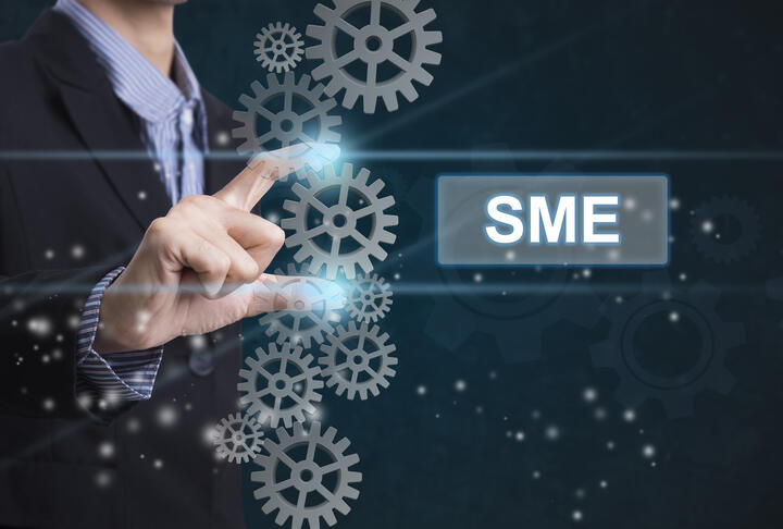 Solving the SME AML De-Risking Burden Using the Blockchain