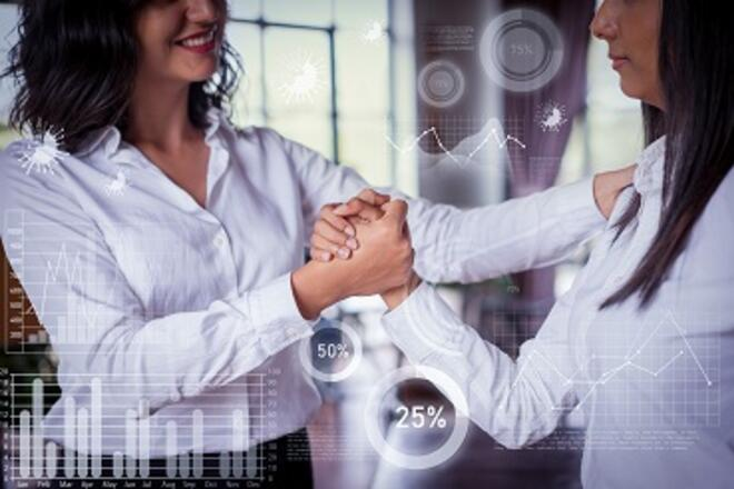 two women shaking hands with financial graphs as filter