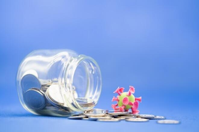 jar with coins and a coronavirus cell toy