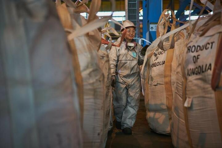 Worker with protective gear walking on a factory in Mongolia